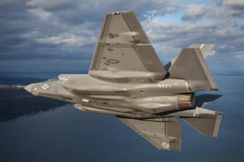 Картинка авиация боевые+самолёты американец бомбардировщик берег пейзаж lightning ii f-35 море тучи небо полет