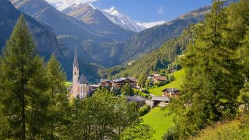 Картинка heiligenblut village austria города пейзажи деревня горы деревья церковь дома австрия склон